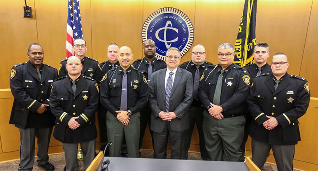 photo of sheriff officers and armond budish