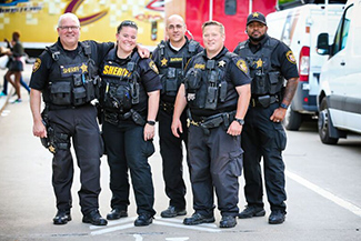 photo of sheriff officers outside the Q arena