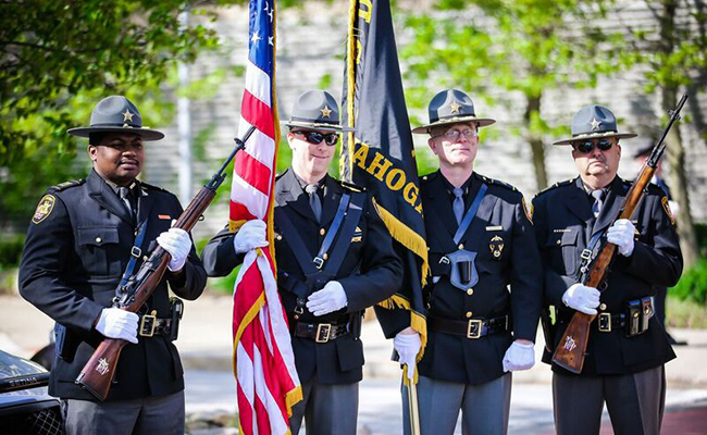 photo of sheriff officers holding the flag
