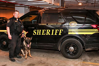 photo of sheriff officer with a K9